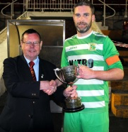 Tom Fitzgerald presenting Kieran Walsh, Park United B, with the Saxone Cup