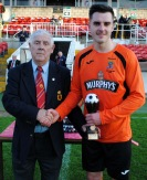 Jack Walsh (Innishvilla) receiving the Man of the Match award from Ted O'Mahony (Cork AUL)