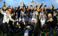 Donoughmore Athletic players and supporter celebrate after their victory in the Corinthian's Cup