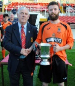 Ger Rice (captain of Innishvilla) receiving the AOH Cup from Ted O'Mahony (Cork AUL)