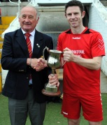 City Wanderers Derek Peyton receives the City Challenge Cup from Richard Browne (Cork AUL)
